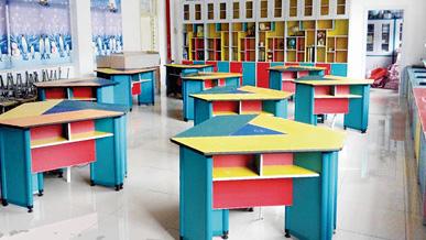 合适的学生阅览桌椅可改善学生脊柱